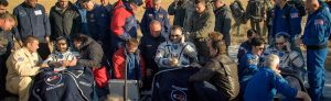 Visiting astronaut Hazzaa Ali Almansoori of the United Arab Emirates, left, Expedition 60 crewmembers Alexey Ovchinin of Roscosmos, center, and Nick Hague of NASA sit in chairs outside the Soyuz MS-12 spacecraft after they landed in a remote area near the town of Zhezkazgan, Kazakhstan on Thursday, Oct. 3, 2019. Hague and Ovchinin are returning after 203 days in space where they served as members of the Expedition 59 and 60 crews onboard the International Space Station. Almansoori logged 8 days in space during his first flight as an astronaut. Photo Credit: (NASA/Bill Ingalls)