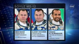 NASA astronaut Nick Hague, Russian cosmonaut Alexey Ovchinin and visiting astronaut from United Arab Emirates (UAE) Hazzaa Ali Almansuri