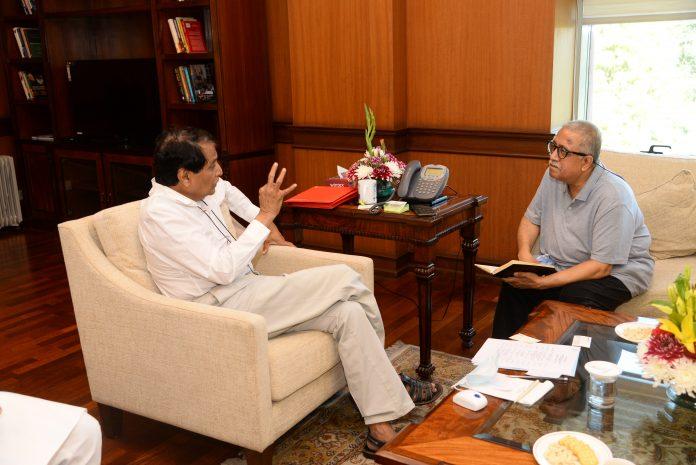 Suresh Prabhu with Arvind Passey